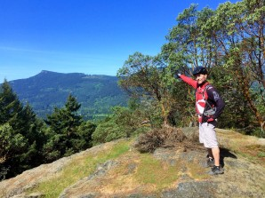 Trail Guide Aaron at Richards lookout. Mt Prevost in background